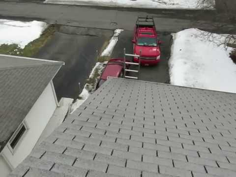 Home Roof Inspection in Albany NY with missing granules on the shingles
