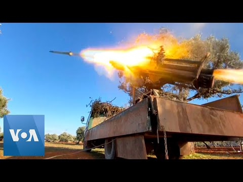Syria Rebels Fire Rockets At Regime Forces In Idlib Countryside