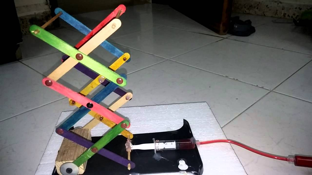 Make a scissor lift with household items youtube for Household design items