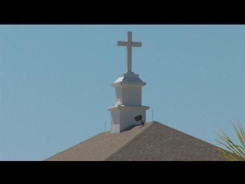 Neighbors, church still at odds over radio antenna