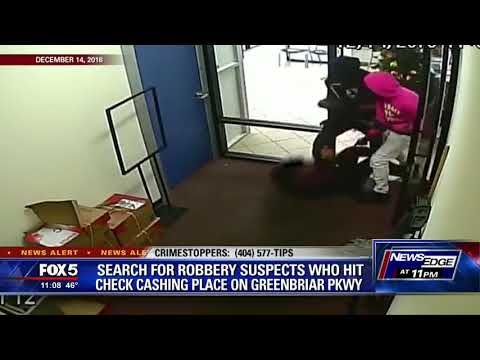 Search For Robbery Suspects Who Hit Check Cashing Place