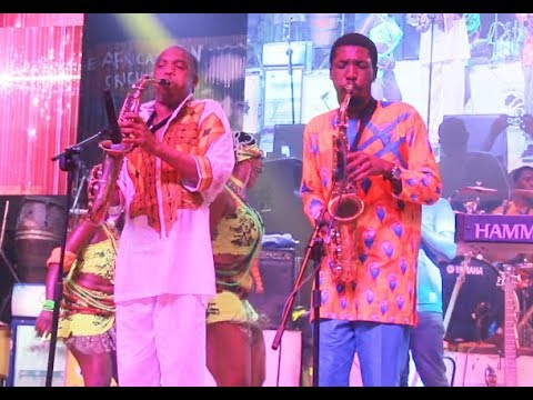 Femi Kuti's first son storms the stage to challenge his father in playing sax at Felabration 2018