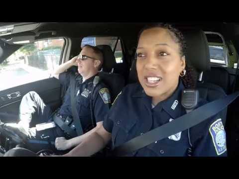 Boston police officers sing 'God Bless America' in cruiser