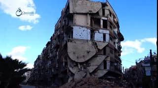 وكالة قاسيون تضرر المباني بشكل كبير نتيجة القصف  على مدينة عربين بريف دمشق 5-12-2015