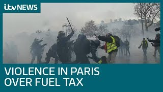 Injuries and arrests as Paris fuel tax protests turn violent | ITV News