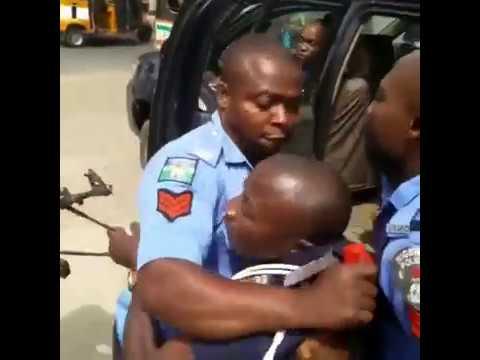 Nigerian Police Men and Civil Defense Officer In Brutal Fight
