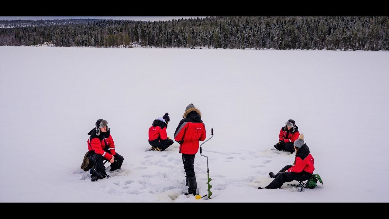 Ice fishing safari in Rovaniemi with Santa Claus Reindeer resort in Lapland Finland winter fishing