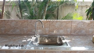 Installing a sink in my outdoor kitchen.