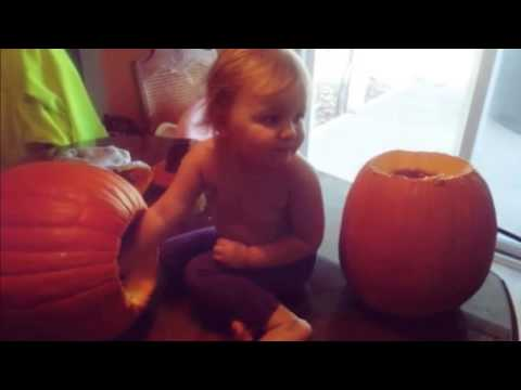 Ava cleaning out her pumpkin