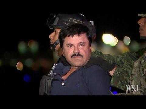 "Bos kartel Sinaloa, Joaquin ""El Chapo"" Guzman saat sedang menuju pengadilan di New York (gambar dari: https://www.youtube.com/watch?v=Ghc5gXA3nAw)"