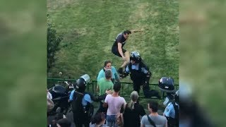 Romanian Protester Kicks A Police Officer In The Back Really Hard