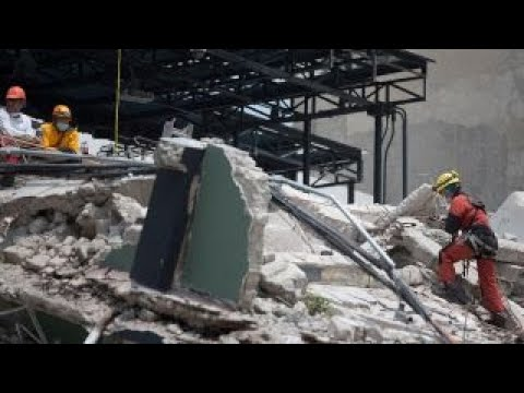 Rescuers race to find survivors among rubble in Mexico City