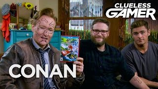 "Download Clueless Gamer: ""Mario Kart 8"" With Seth Rogen & Zac Efron  - CONAN on TBS Mp3 and Videos"