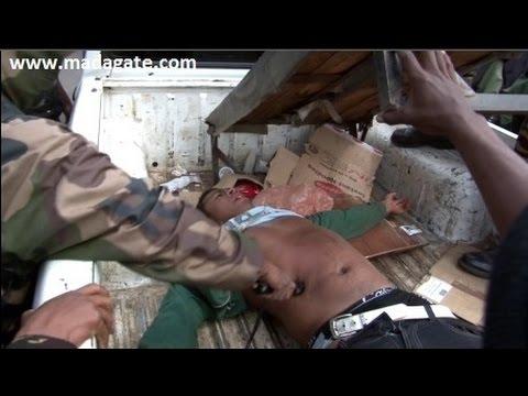 Madagascar. Gendarmes torturing student 1 Sept 2015