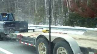 ford ranger towing a dump truck