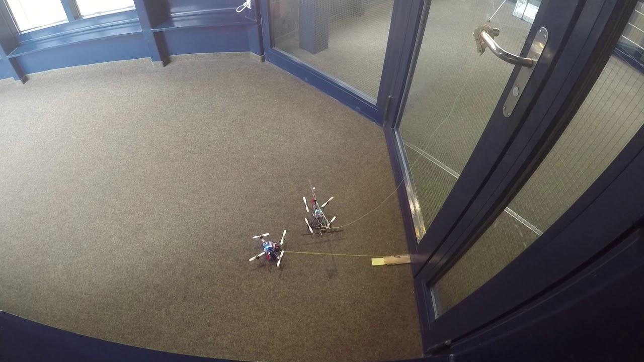 'FlyCroTug' Drones Work Together to Open a Door
