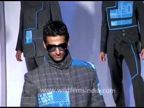 Hunky Indian male models walk the ramp at Delhi fashion show