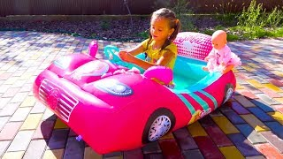 Fillip and Sasha play with inflatable swimming pools cars and Water Balloons