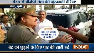 Vidoe: BJP leader Fight with meerut police on the road in UP