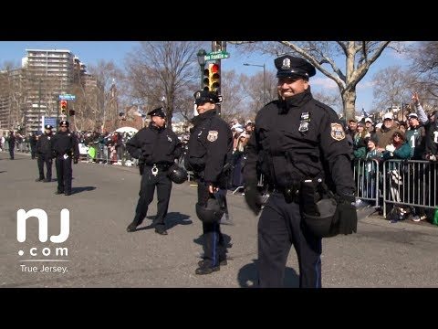 Philadelphia Police play catch with Eagles fans along parade route