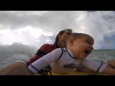 9-month old baby goes YOLO with his surfer daddy into the waves!