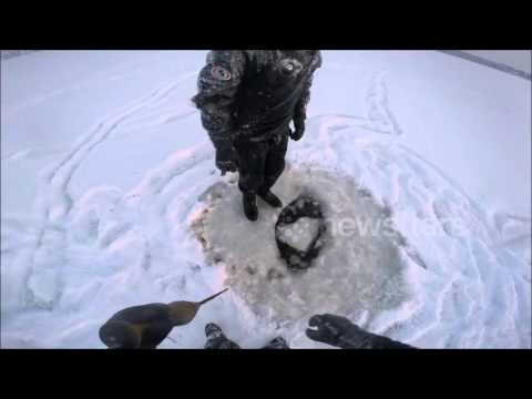 Sunken snowmobile retrieval  from under ice Part 1