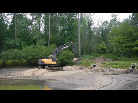 Excavator Working On Mud Mats