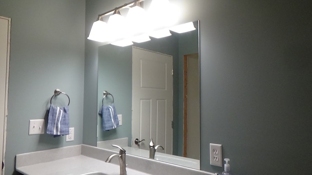 How To Install A Mirror Using Adhesive Gluing A Vanity