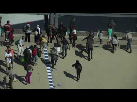 Migrants try fence breach, US agents fire tear gas