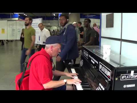 Mailman Plays Stunning Piano in a  Frantic Environment