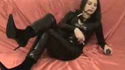 Wild sexy webcam hottie smoking in latex suit - amateur fetish video