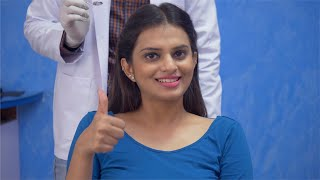 Video of a happy female client giving thumbs up and smiling at dental clinic