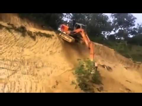 Excavator Operator Drops Off Steep Embankment - To Save Time!