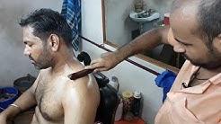 Wood stick head massage and body massage by Reiki master.