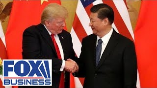Trump signs phase one of US-China trade deal