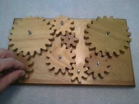 Wooden gear system (puzzle/toy) - YouTube