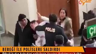 Babeğiyle polise saldıran kadın. Kadın şiddeti, çocuğa şiddet.