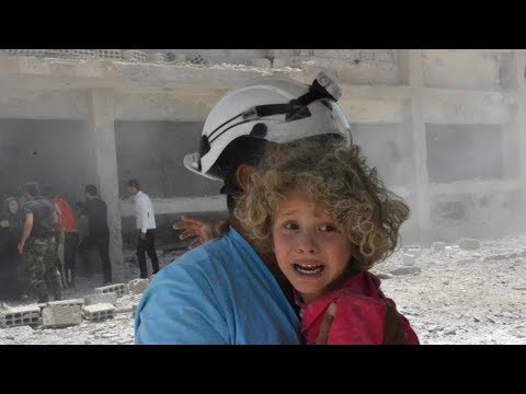 White Helmet volunteers rescued from Syria in dramatic escape