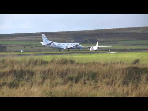 Flybe SAAB 340 landing at Kirkwall Airport, Orkney Islands, Scotland