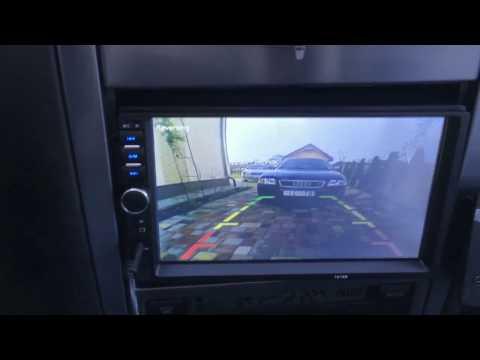 Китайская авто мультимедия 7018B с камерой заднего вида за 55$