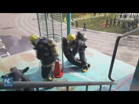 Firefighters in China's Changchun show off skills