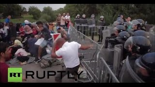 Police pepper spray migrants breaking down EU borders