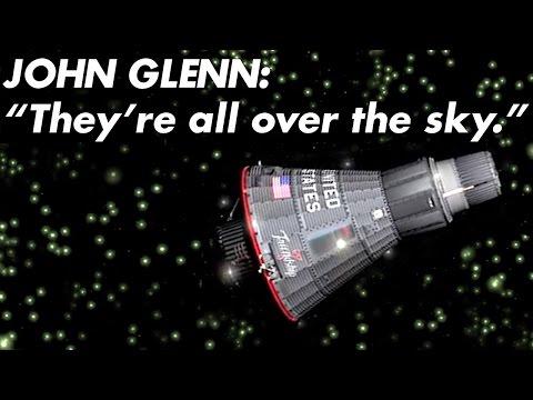 1962  of Astronaut John Glenn Observing Luminescent Particles During Earth Orbit