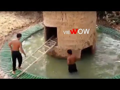 primitive-clay-hut-over-homemade-swimming-pool:-diy-clay-house-and-swimming-pool---viewow