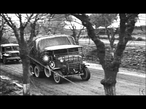 Trucks loaded with Italian soldiers of the Co-Belligerent Army pass signs in Ital...HD Stock Footage