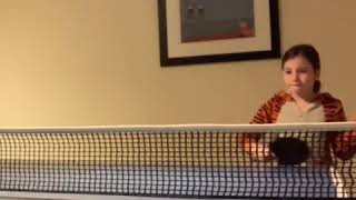 Little Girl Practices Skills in Table Tennis - 1025367