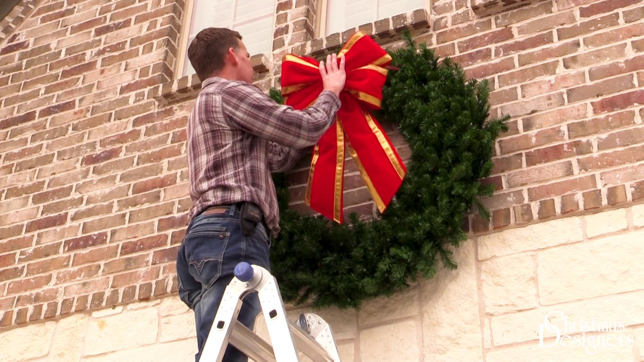 Hanging a Christmas Wreath on Brick - Pro Installation Tips - Christmas Designers