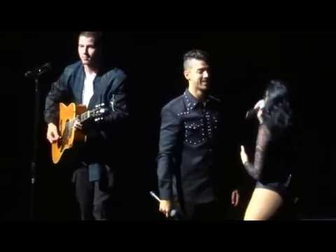 "Joe Jonas and Demi Lovato singing ""This is Me"" with Nick on guitar"