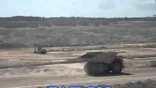 Caterpillar 793-F 240 Ton Trucks Working