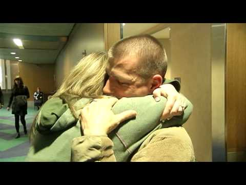Soldier surprises wife at Portland airport